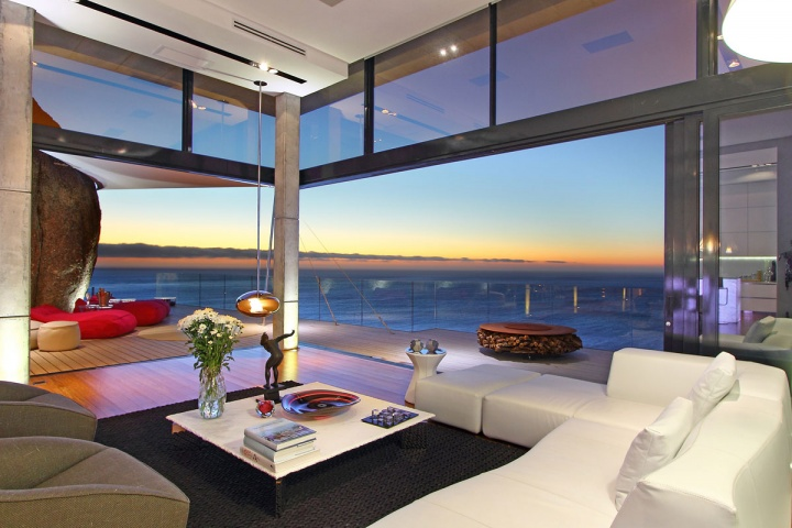 night-open-concept-living-room-ocean-view